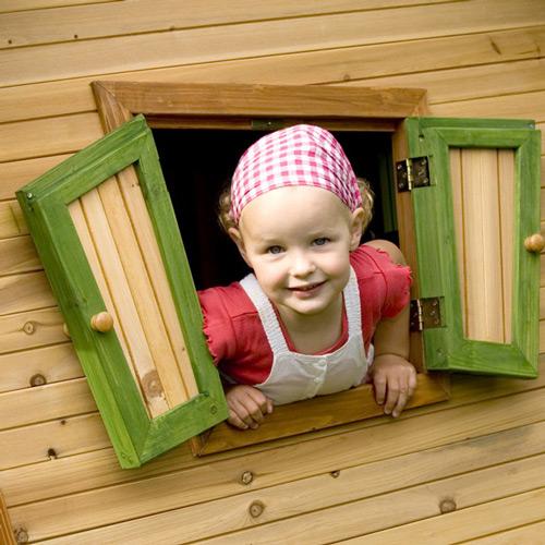 kinderspielhaus f r den garten aus holz aus kunststoff auf stelzen und mit rutsche oder. Black Bedroom Furniture Sets. Home Design Ideas